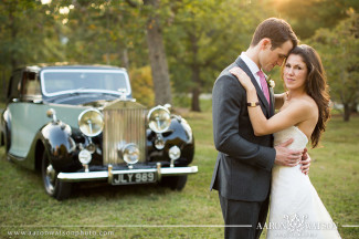 bride and groom with roles royce