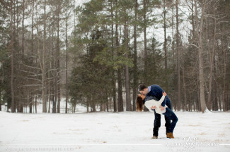 couple dipping in a snowy field